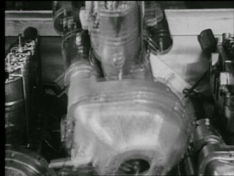 stockvideo's en b-roll-footage met b/w 1927 close up engine being lowered into crate / industrial - 1927