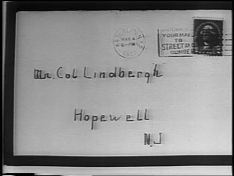 b/w 1935 close up envelope of ransom note mailed to lindbergh after kidnapping / newsreel - 1935 stock videos & royalty-free footage