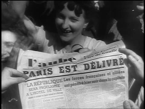 """close up excited french people holding up newspaper with headline """"paris est delivre"""" at liberation - western script stock videos & royalty-free footage"""