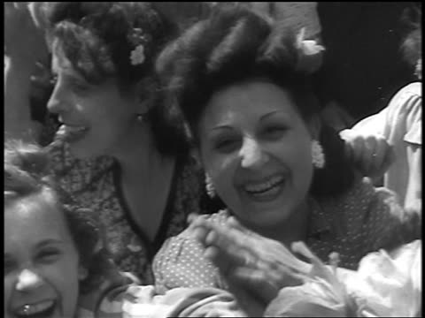 pan close up excited frenchwomen smiling waving at camera at liberation of paris / doc - 30 39 years stock videos & royalty-free footage