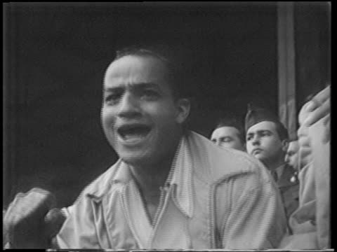 vidéos et rushes de close up excited man in audience shouting + punching air at playoff game / polo grounds - 1951