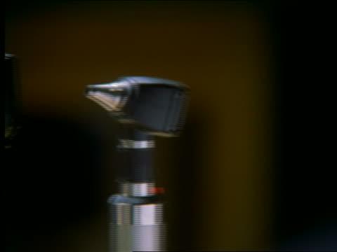 close up PAN eye, ear + throat examining equipment