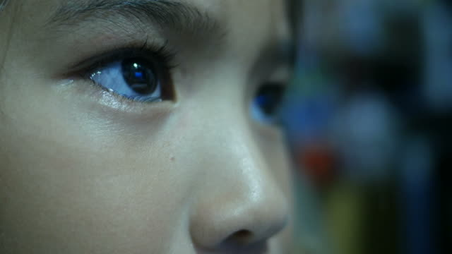 close up face of asian girl while looking at computer - concentration stock videos & royalty-free footage