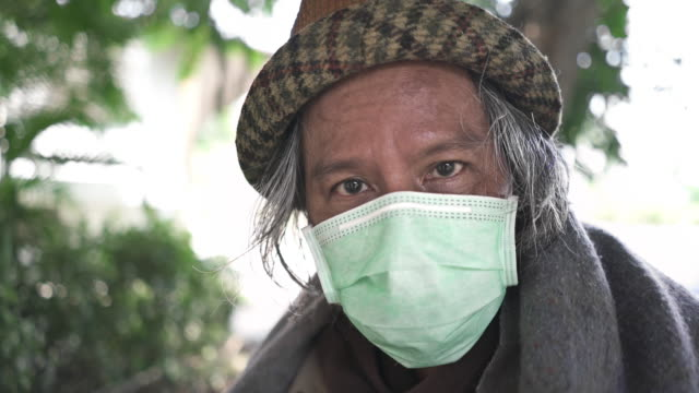 cu close up face of homeless man senior man looking at the camera - homelessness stock videos & royalty-free footage