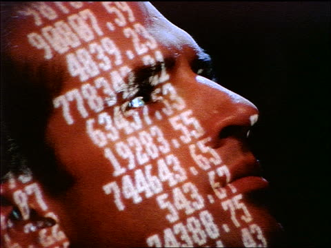 close up face of man with numbers projected onto him / turns head - one mid adult man only stock videos & royalty-free footage