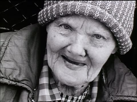 b/w close up face of senior homeless woman looking around - ugliness stock videos and b-roll footage