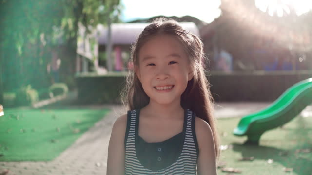slo mo close up face of smile happy asian girl - girls stock videos & royalty-free footage