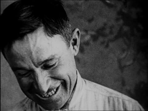 b/w 1925 close up face of will rogers smiling / documentary - 1925 stock videos & royalty-free footage
