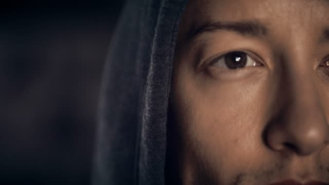close up face of young man in hooded shirt - sweat stock videos & royalty-free footage