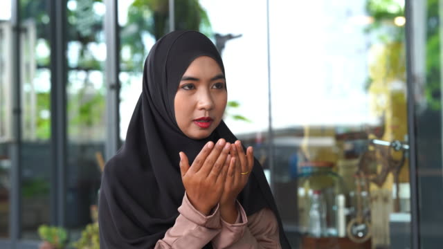 close up face young asian muslim woman , praying and prostrating , praying namaj time - religion stock videos & royalty-free footage