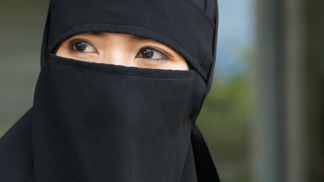 close up face young asian muslim woman - burka stock videos & royalty-free footage