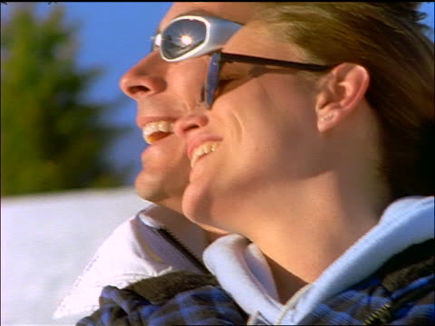 vídeos y material grabado en eventos de stock de close up faces of couple wearing sunglasses embracing + smiling - pareja de mediana edad