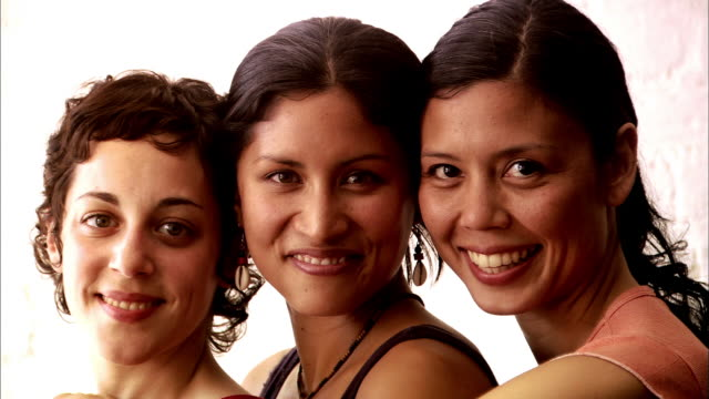 close up faces of three women smiling - freundin stock-videos und b-roll-filmmaterial