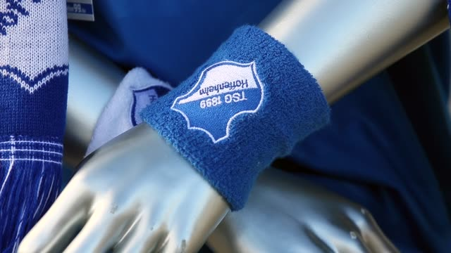 stockvideo's en b-roll-footage met close up fan articles of the tsg 1899 hoffenheim are seen in front of the wirsol rheinneckar arena prior to the bundesliga match between tsg 1899... - 1899