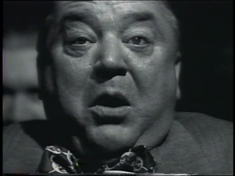 b/w 1958 close up fat middle-aged man putting fingers in mouth - disgust stock videos & royalty-free footage