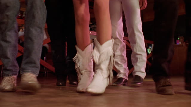close up feet of men and women country line dancing / reno - country and western stock videos & royalty-free footage