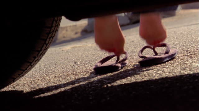 close up feet stepping into sandals outdoors - flip flop stock videos and b-roll footage