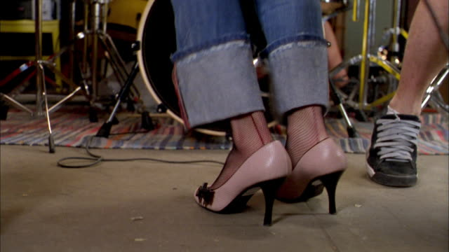 close up  feet w/cuffed jeans and pink high heel shoes jumping while performing  w/band - human foot stock videos and b-roll footage