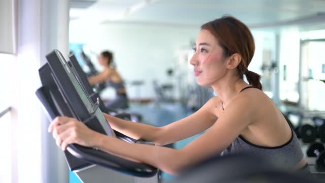 Close up Female Athlete on training bike, Exercise Bike