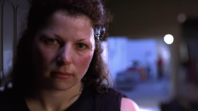 close up PAN female boxer wearing black sleeveless T-shirt in gym