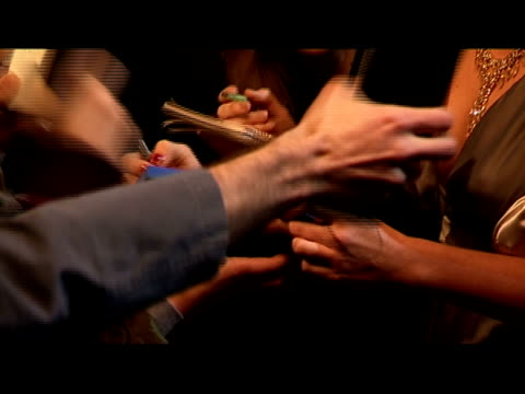 close up female celebrity meeting fans and signing autographs on red carpet/ london, england - autographing stock videos & royalty-free footage