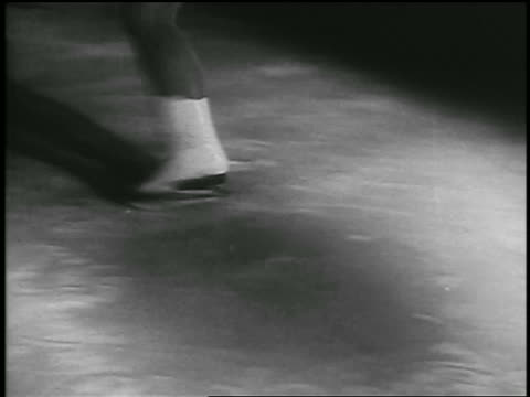 b/w 1935 close up pan female figure skater's feet skating on ice / richmond canada - 1935 stock videos & royalty-free footage