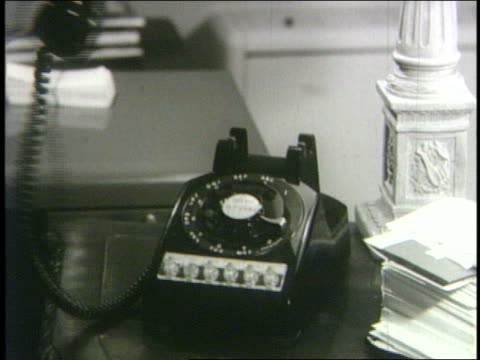 b/w 1962 close up female hand hanging up telephone - hanging up stock videos and b-roll footage