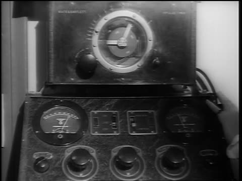 b/w 1948 close up female nurse's hand turning knob on x-ray machine - medizinisches röntgenbild stock-videos und b-roll-filmmaterial