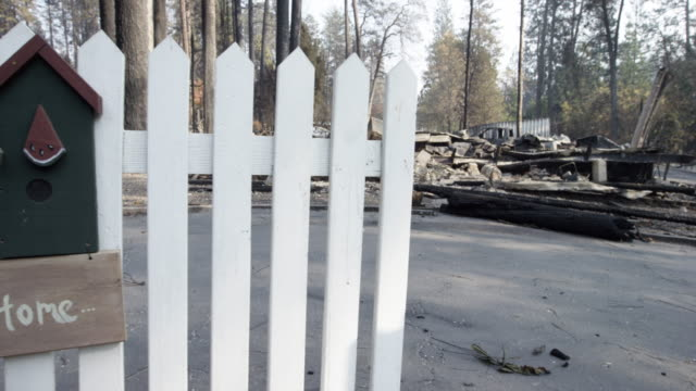close up, fence near burned rubble - home sweet home stock videos & royalty-free footage