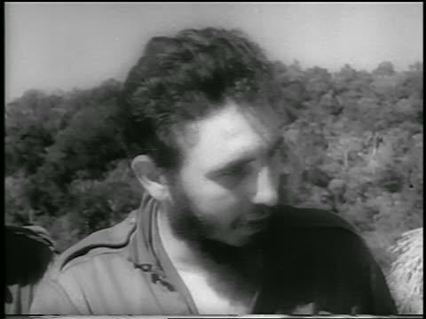 vidéos et rushes de close up fidel castro looking down + to side + talking / cuba / newsreel - 1959