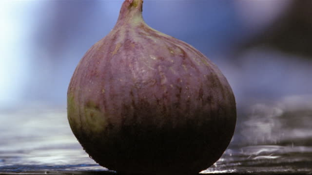 Close up fig being cut in half