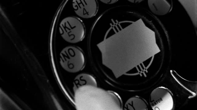 close up finger dialing rotary telephone - rotary phone stock videos and b-roll footage