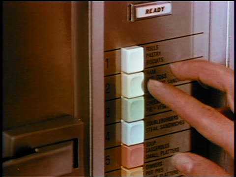 1969 close up finger of woman pushing button on early microwave / industrial - schieben stock-videos und b-roll-filmmaterial