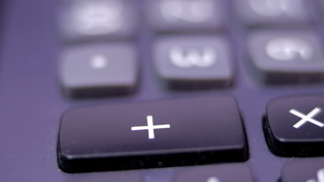 close up finger pressing plus key on calculator. - plus key stock videos & royalty-free footage