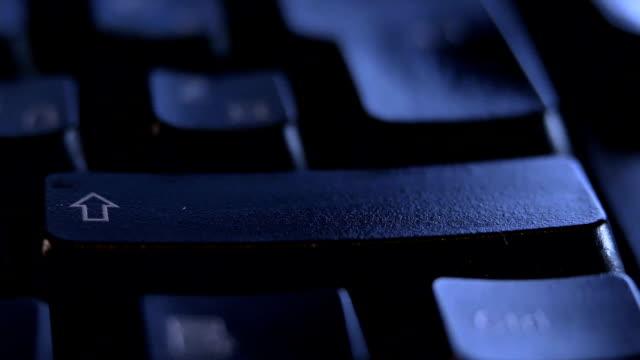 close up finger pressing shift key on keyboard. - shift key stock videos & royalty-free footage