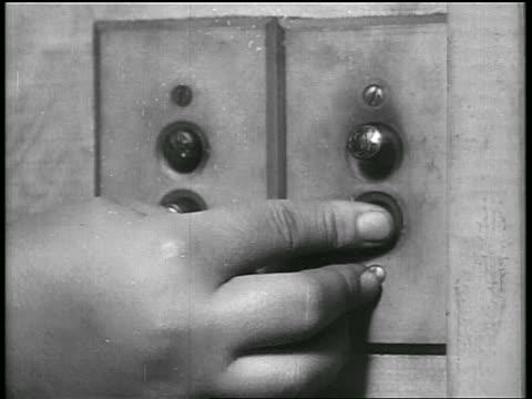 b/w 1928 close up finger ringing doorbell / oklahoma / newsreel - 1928 stock videos & royalty-free footage