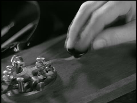b/w close up fingers pressing telegraph clicker - telegraph machine stock videos & royalty-free footage