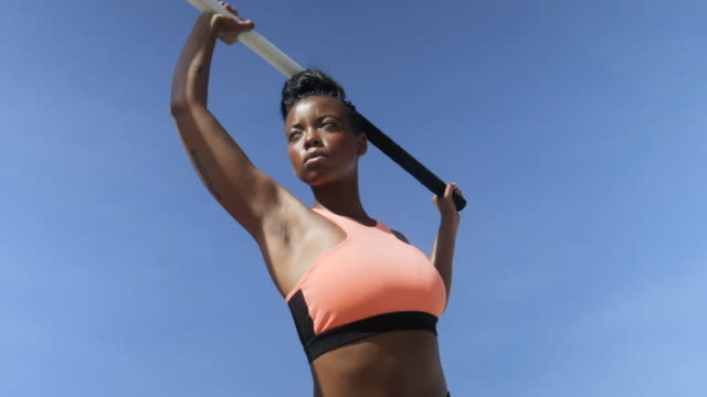 close up, fit african american woman holds pole vault - fashionable stock videos & royalty-free footage