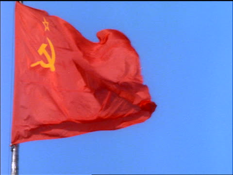 close up flag of Soviet Union waving in wind / blue sky background