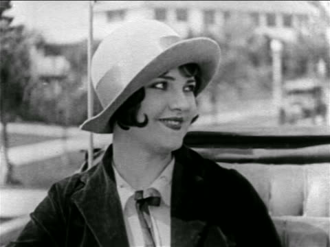 b/w 1927 close up flapper with hat sitting + smiling in convertible driving on street / feature - 1927 stock videos & royalty-free footage