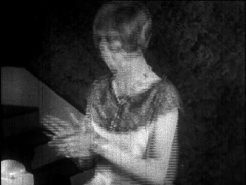 b/w 1926 close up flapper woman clapping hands together + exiting offscreen / newsreel - 1926 stock videos & royalty-free footage