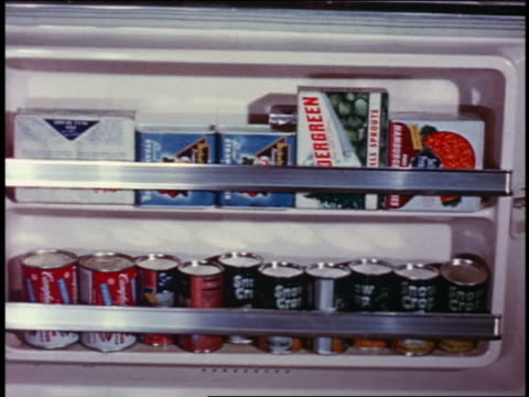 1958 close up food in shelves of freezer door - frozen food stock videos & royalty-free footage