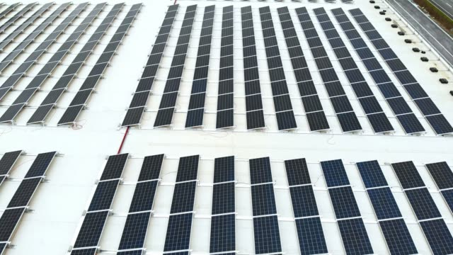 close up footage of solar panels lined up on the roof - roof stock videos & royalty-free footage
