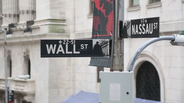 Close up footage of the Wall Street and Nassau Street signs near the New York Stock Exchange in New York NY on August 28 2017 Photographer Michael...