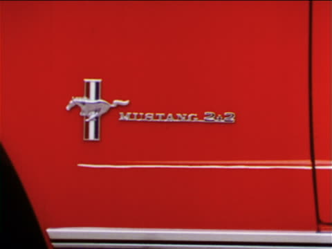 1965 close up ford mustang 2+2 insignia on red car / industrial - ford mustang stock videos and b-roll footage