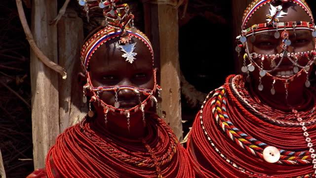 close up pan four young masai tribeswomen / kenya - masai stock videos and b-roll footage