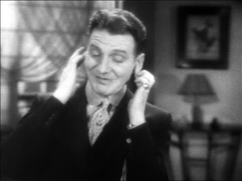 b/w 1931 close up frank fay sticking fingers in ears / feature - 1931 stock videos & royalty-free footage