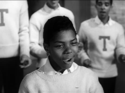 B/W 1956 close up Frankie Lymon singing on small stage / Teenagers in background