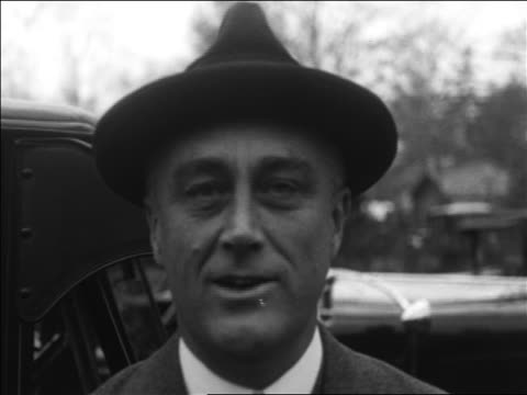 b/w 1932 close up franklin roosevelt talking taking off hat / accepting nomination - 1932 stock-videos und b-roll-filmmaterial