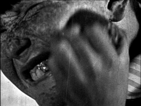 b/w 1927 close up freckle-face boy scrubbing face with lemon / educational - washing face stock videos & royalty-free footage